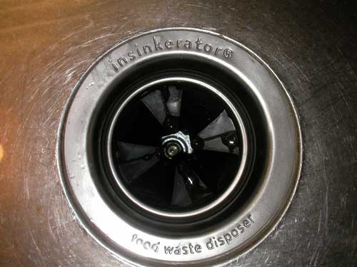 top of a garbage disposal in a sink