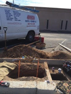 amigo crew working on a sewer line