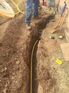 trench in a yard with a new gas line in it